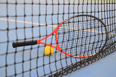 Tennis ball and tennis racket Stock Photos