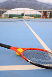 Tennis ball and tennis racket Stock Image