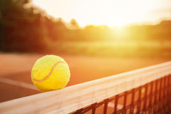 Tennis ball touching the net royalty free stock photos