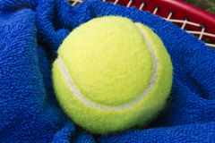 Tennis ball and towel. Tennis ball on a blue towel Stock Image