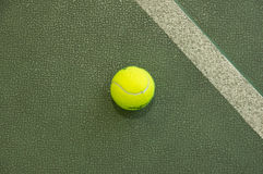 Tennis ball. Wallpaper. Tennis ball on the court at the background. Wallpaper Stock Photo