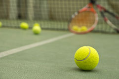 Tennis ball. Wallpaper. Tennis ball on the court with rackets at the background. Wallpaper Royalty Free Stock Photography