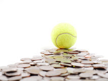 Tennis ball on the way of money prize. Tennis ball on the money prize Stock Photos