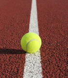 Tennis ball on white line Royalty Free Stock Photo