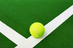 Tennis ball on white line. Of hard court Stock Photography