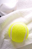 A tennis ball on white towel Stock Photo