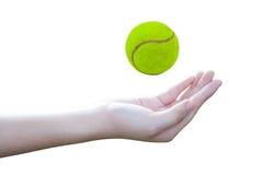 Tennis ball. Woman hands throwing tennis ball Stock Photos