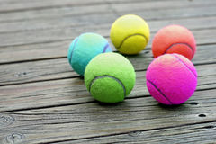 Tennis ball  on wooden background Stock Photos