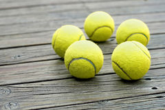 Tennis ball  on wooden background Stock Images