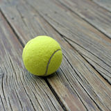 Tennis ball  on wooden background Royalty Free Stock Images