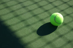 Tennis Balls 1. Tennis ball with the net shadow Royalty Free Stock Images