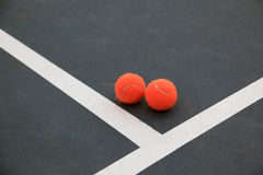 Tennis balls. Two red tennis balls on practice court Royalty Free Stock Photos