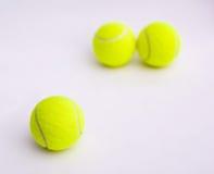 Tennis balls. Three tennis balls on white background Stock Images