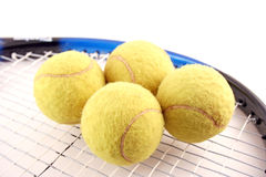 Tennis and balls Royalty Free Stock Image