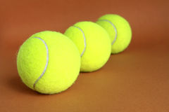 Tennis balls. Tennis  balls on a brown background Stock Photos