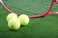 Tennis balls. And rackets on artificial grass Stock Photography