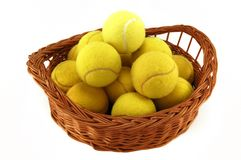 Tennis balls. Lot of tennis balls in the basket isolated on white royalty free stock photos