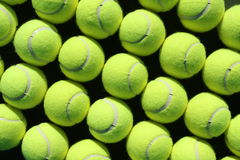 Tennis balls. Rows of tennis balls for background or wallpaper angled Stock Photos