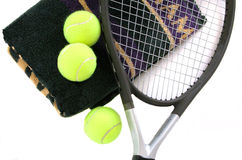 Tennis Balls. Two tennis balls, towel, and a racket royalty free stock images