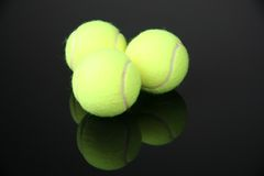 Tennis balls. Three tennis balls over black background stock photography