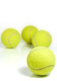 Tennis balls. Yellow tennis balls isolated on a white background, with reflection royalty free stock images