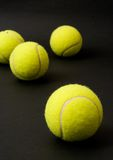 Tennis balls. Yellow tennis balls isolated on a black background stock image