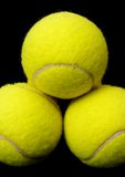 Tennis balls. Yellow tennis balls isolated on a black background stock photography