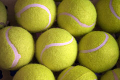 The Tennis balls. Background from yellow close located tennis balls Stock Photography