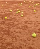 Tennis balls on the clay court. Tennis balls all over the the clay court after trening royalty free stock images