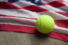 Tennis balls with an American flag on wood table Royalty Free Stock Photography