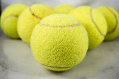 Tennis Balls. Approaching tennis balls set. You can see the texture of the fibers and fluoresce royalty free stock images