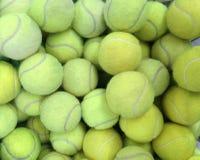 Tennis balls in basket Stock Photo