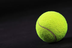 Tennis balls on black background studio shot Stock Photo
