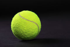 Tennis balls on black background studio shot Stock Image