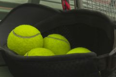 Tennis balls in black sport hat royalty free stock images