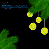 Tennis balls on Christmas tree branch Royalty Free Stock Photo