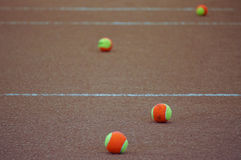 Tennis balls on clay court Royalty Free Stock Image