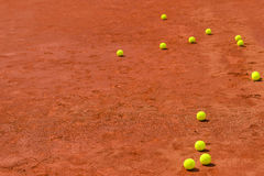 Tennis balls on clay court Stock Photos