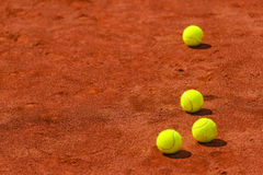 Tennis balls on clay court Stock Images