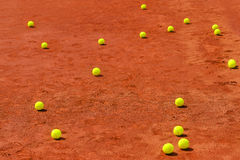 Tennis balls on clay court Stock Image