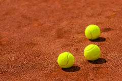 Tennis balls on clay court Royalty Free Stock Photography