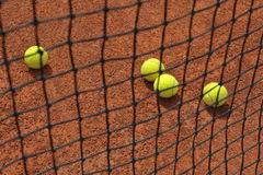 Tennis balls on clay court Royalty Free Stock Photo
