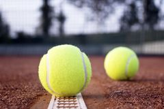 Tennis balls on the clay tennis court. royalty free stock image