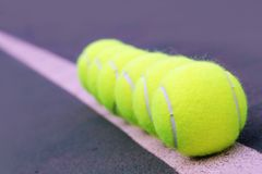 Tennis balls closeup on hard court tennis turf Stock Photo