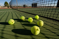 Tennis balls and court Royalty Free Stock Image