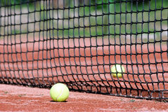 Tennis balls on court Royalty Free Stock Photography