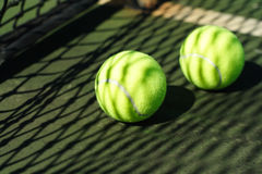 Tennis balls in court Royalty Free Stock Photos