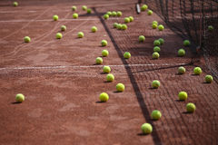Tennis balls on court Stock Photography