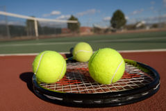 Tennis balls, court, racquet Royalty Free Stock Image