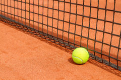 Tennis balls on court Royalty Free Stock Image